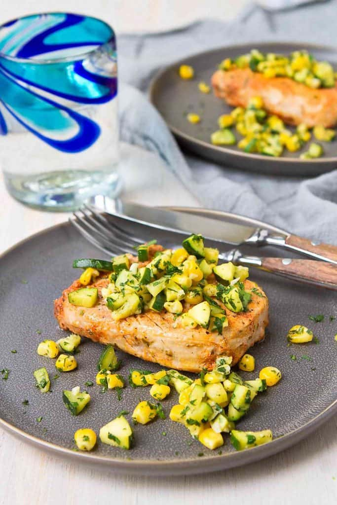 These easy broiled pork chops are rubbed with a spice mixture, cooked in less than 10 minutes, then topped with a sauteed zucchini and corn salsa. 323 calories and 4 Weight Watchers Freestyle SP