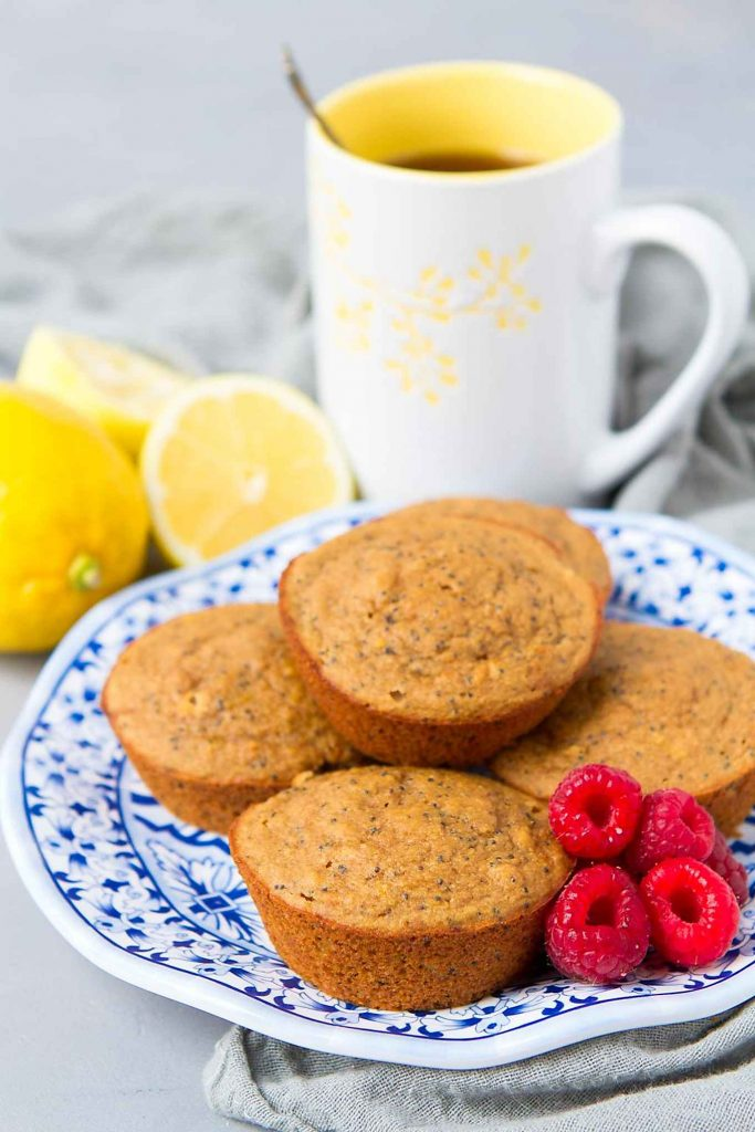 These light and brightly flavored Healthy Lemon Poppy Seed Muffins, which are also gluten free, are fantastic for on-the-go breakfasts or snacks. Easy to freeze! 128 calories and 4 Weight Watchers Freestyle SP #glutenfree #muffins