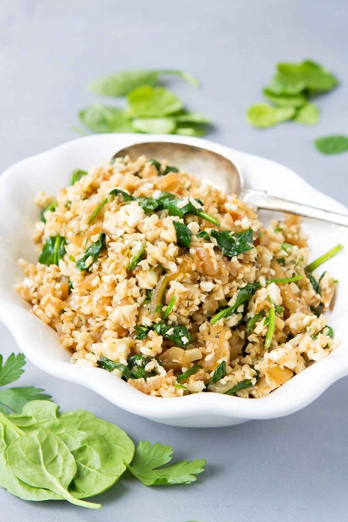 This healthy cauliflower rice recipe is packed with flavor, thanks to caramelized onions, spinach and feta cheese. 76 calories and 2 Weight Watchers Freestyle SP