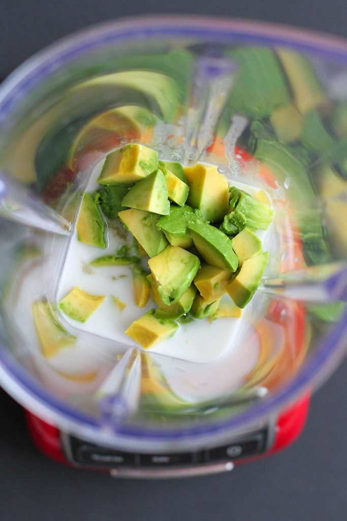 California avocado and coconut milk in a blender.