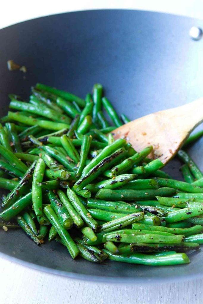 Green beans in a nonstick wok for a quick green bean recipe.