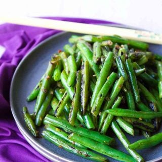 This Spicy Green Bean Stir Fry recipe is one of the easiest and most flavorful side dishes! So much flavor with just a few ingredients. 76 calories and 1 Weight Watchers Freestyle SP