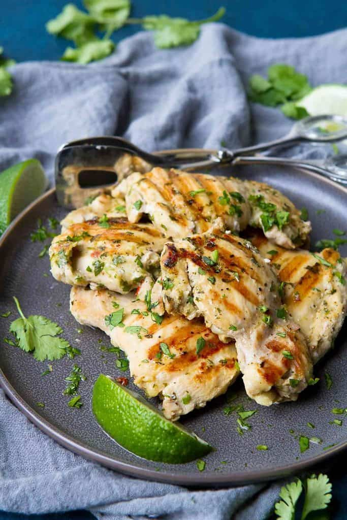 There's nothing easier than whipping up a batch of this Grilled Cilantro Lime Chicken for dinner! Plus, it can be made ahead and frozen. 217 calories and 3 Weight Watchers Freestyle SP
