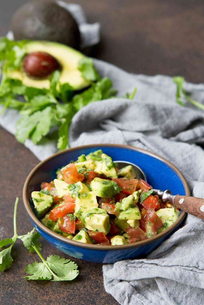 Fresh avocado salsa, with tomatoes, lime juice and cilantro.