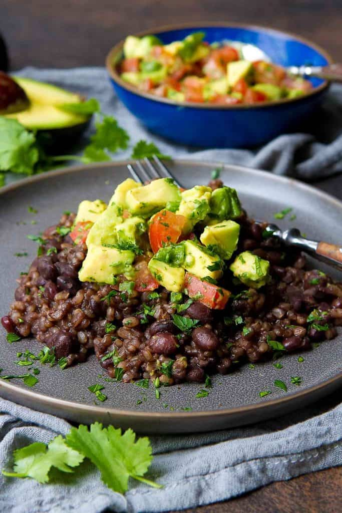 You can't beat Instant Pot Black Beans and Rice with Fresh Avocado Salsa for a healthy, economical, vegan meal that comes together easily! 268 calories and 6 Weight Watchers Freestyle SP