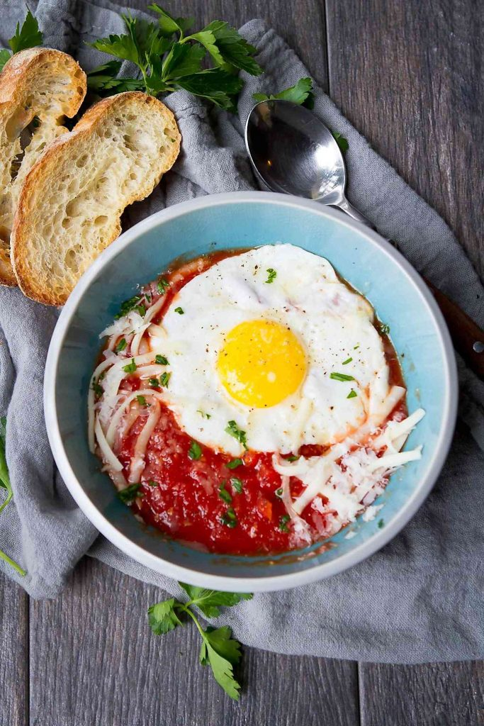 This Italian Eggs in Purgatory recipe is easy cooking at its best. Tons of flavor with few ingredients! 240 calories and 3 Weight Watchers Freestyle SP