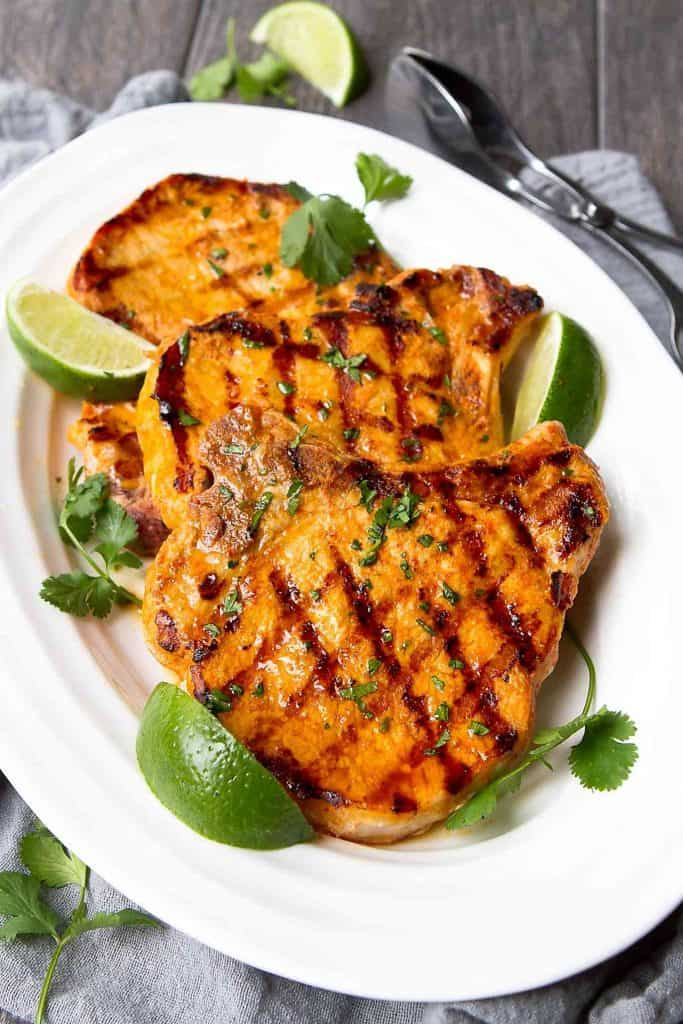Grilled pork chops have so many things going for them. Quick, easy and economical, plus they can take on almost any flavors. These ones are rocking a Thai curry marinade! 279 calories and 6 Weight Watchers Freestyle SP