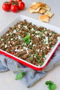 Flavor bomb alert! From the spiced ground beef to the hummus yogurt mixture and fresh veggies, this Beef Kofta Dip recipe will keep you dipping all day long. 146 calories and 3 Weight Watchers Freestyle SP #dip #appetizer #recipe
