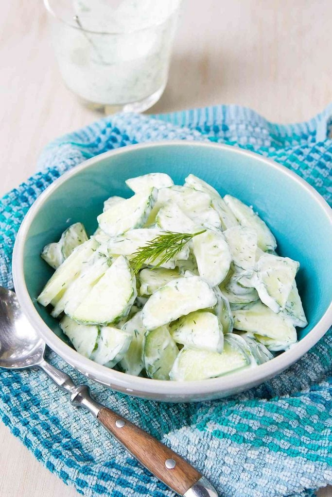 This cucumber dill salad can be whipped up in just 10 minutes! A healthy side dish for weeknights or backyard barbecues. 24 calories and 0 Weight Watchers Freestyle SP #salad #glutenfree #cucumber #recipe