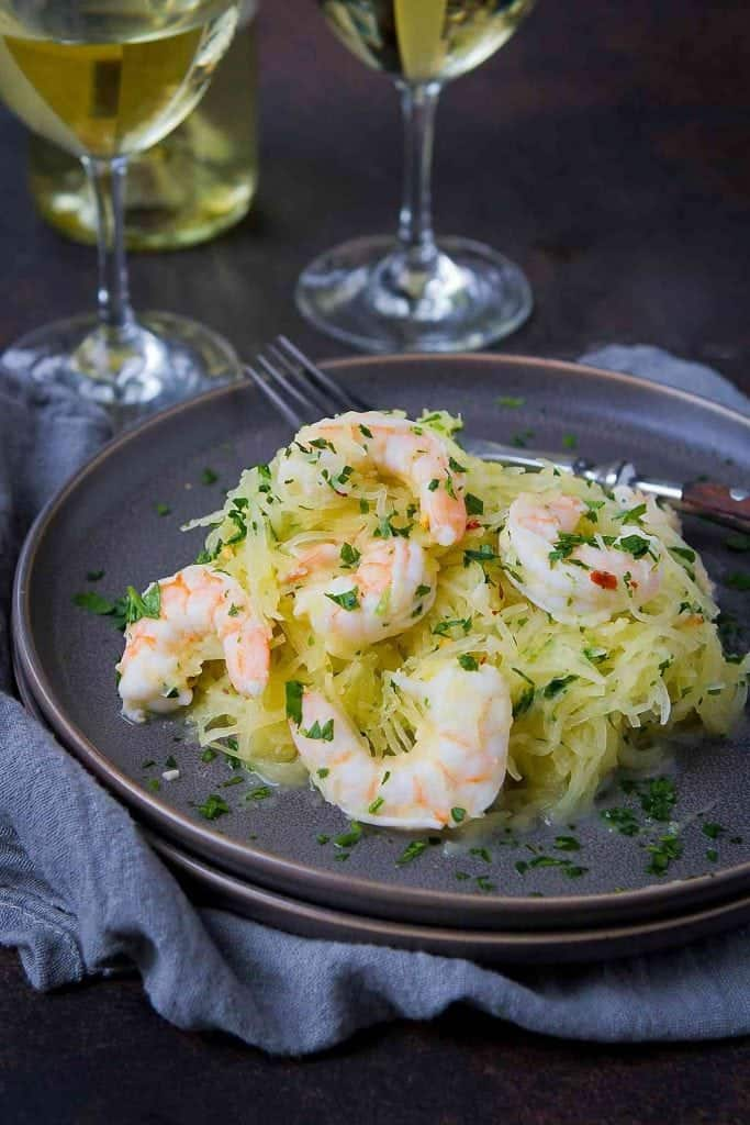 Shrimp scampi takes a low carb turn by replacing the standard dose of pasta with spaghetti squash. Unbelievable flavor in just 30 minutes! 243 calories and 3 Weight Watchers Freestyle SP #shrimp #spaghettisquash #lowcarb