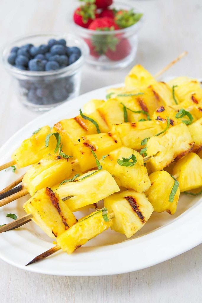 Grilled pineapple is one of my family's favorite summertime desserts. Tangy and sweet with a little lime and honey brushed over top. 72 calories and 2 Weight Watchers Freestyle SP #recipe #grilled #dessert #pineapple