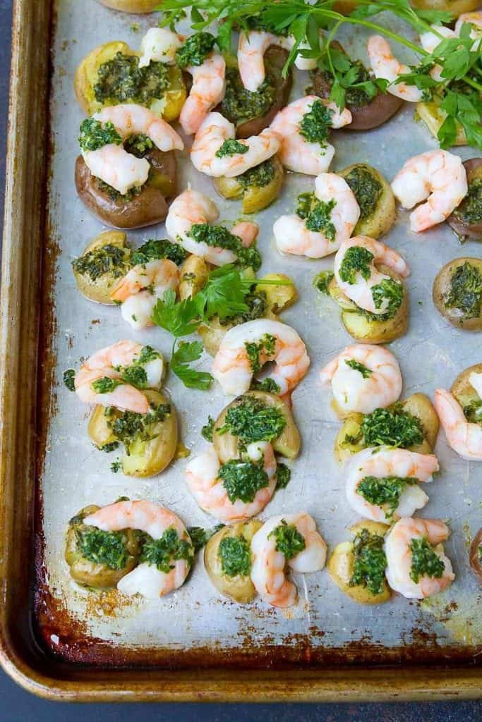 Easy clean up and tons of flavor in this Chimichurri Shrimp and Potato Sheet Pan Meal. Another healthy weeknight dinner idea. 381 calories and 8 Weight Watchers Freestyle SP #cleaneating #sheetpan #CreamerPotatoes
