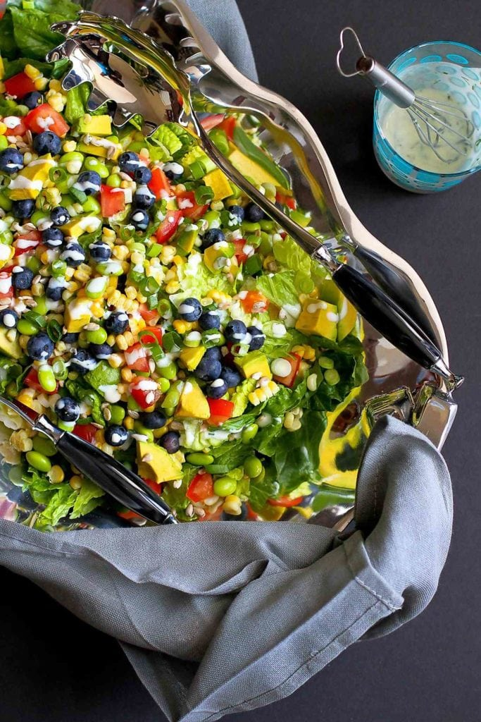 Corn, blueberries, avocado and tomatoes make this the ultimate summer salad recipe! Drizzled with a light dill buttermilk dressing. 134 calories and 1 Weight Watchers Freestyle SP