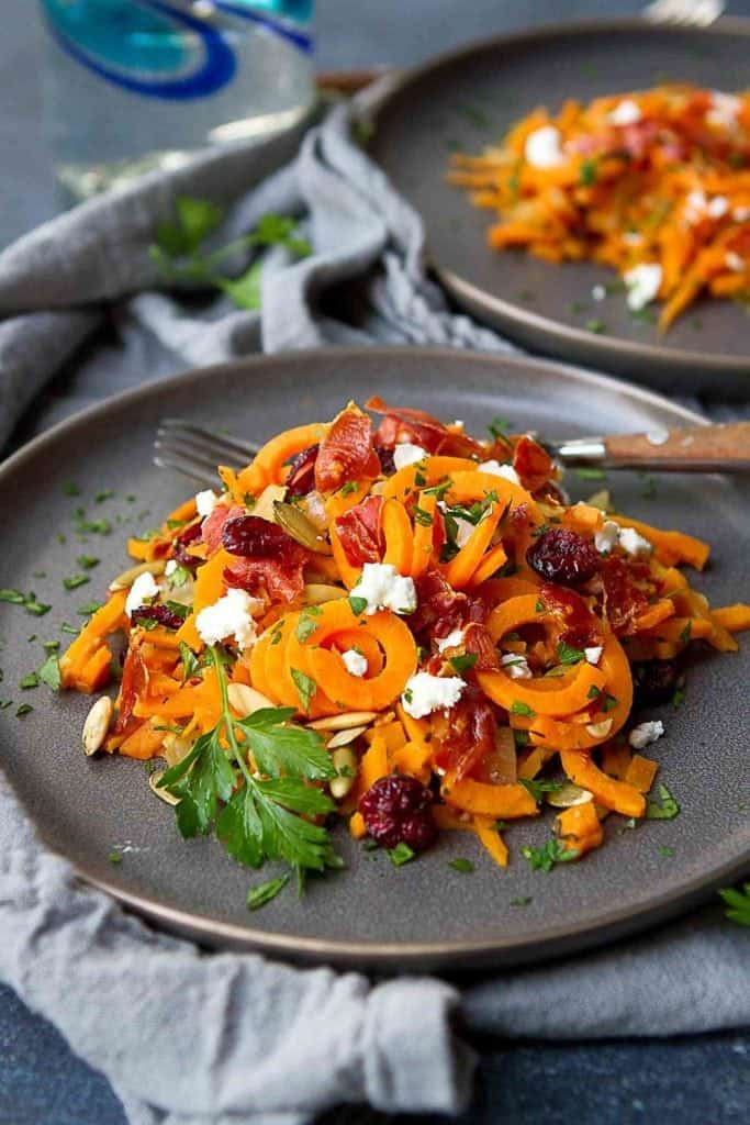 Sweet potato noodles are spruced up with crispy prosciutto, dried cranberries and creamy goat cheese. The perfect autumn side dish! 167 calories and 6 Weight Watchers Freestyle SP #sweetpotato #recipe