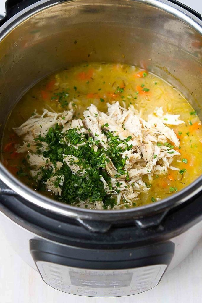Ingredients for chicken soup with rice in an Instant Pot.