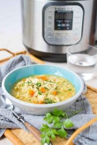 Chicken and Rice Soup is one of our favorite comfort meals and it comes together so easily in the Instant Pot! 241 calories and 5 Weight Watchers Freestyle SP #instantpot #soup #cleaneating