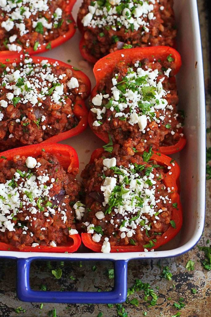 So many fantastic flavors in this hearty and healthy meal of Greek Stuffed Peppers with Feta Cheese! 226 calories and 5 Weight Watchers Freestyle SP #recipe #dinner