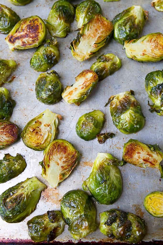 If you have always wondered how to roast Brussels sprouts, this tutorial is for you! Roasted Brussels sprouts are the ultimate fall or holiday side dish! #Brusselssprouts #cleaneating #howto
