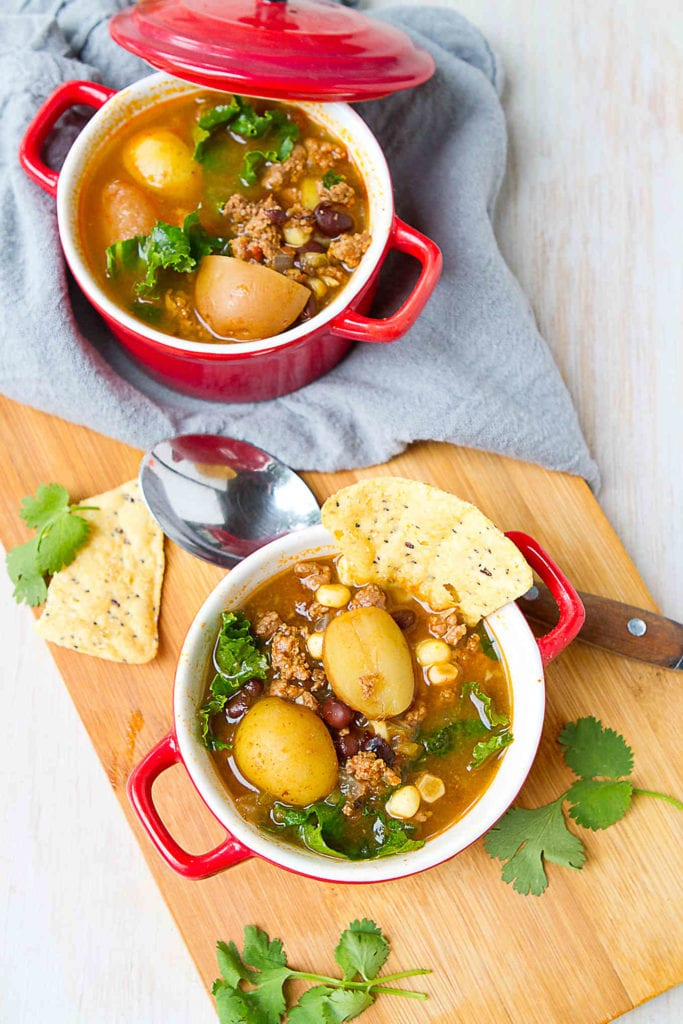Raise your hand if you love taco soup! This Instant Pot recipe, packed with potatoes and kale, will become a favorite in no time. 267 calories and 4 Weight Watchers Freestyle SP #soup #pressurecooker #dinner