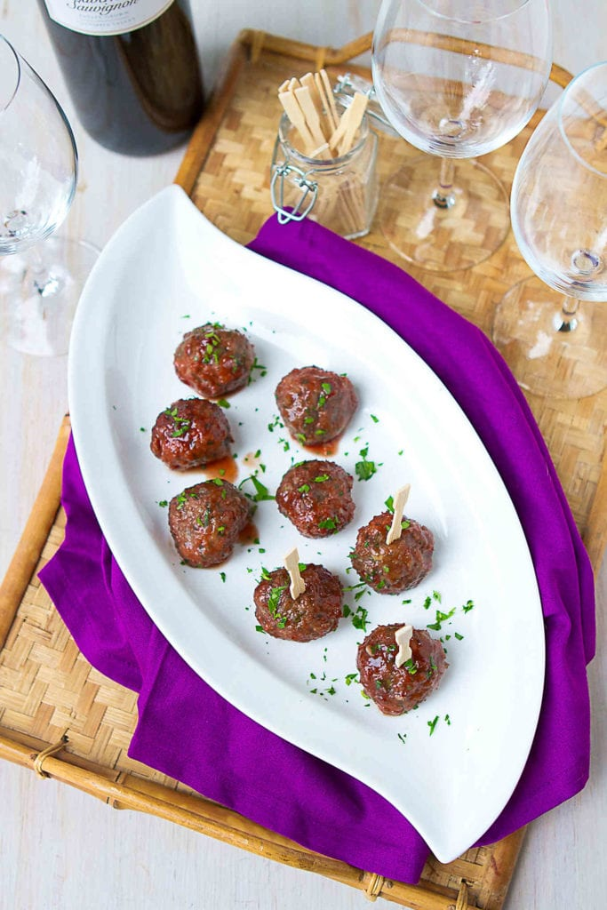 Slow cooker meatballs are the way to go when you are feeding a crowd! These lightened up meatballs are glazed with a blackberry chili sauce. 115 calories and 3 Weight Watchers Freestyle SP #slowcooker #meatball #recipe