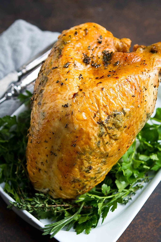 Roast turkey breast is a fantastic option for option for a smaller feast over the holidays. Flavored with herbs and olive oil. 190 calories and 2 Weight Watchers Freestyle SP #turkeybreast #recipe