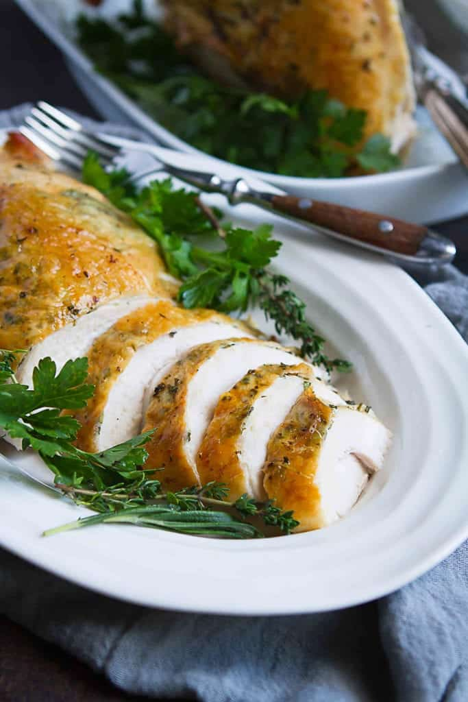 When the Thanksgiving mood hits, but cooking a whole turkey sounds like too much, this Herb Roasted Turkey Breast recipe does the trick! Easy, tender and flavorful. 190 calories and 2 Weight Watchers Freestyle SP #turkey #thanksgiving #turkeybreast #weightwatchers