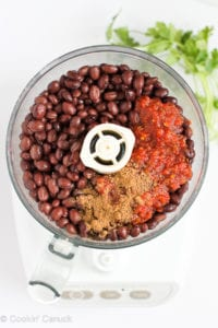 Black beans, salsa and spices in a food processor.