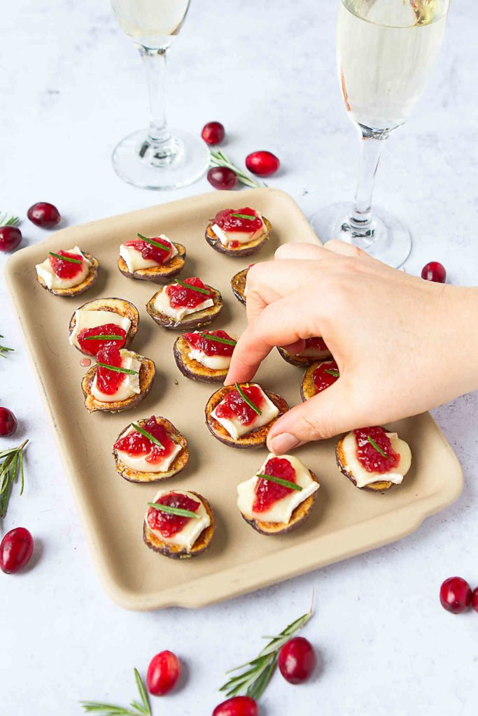 Potato appetizers are so easy to make and are always popular! These melted Brie bites are fantastic for cocktail parties or game day. 51 calories and 2 Weight Watchers Freestyle SP #superbowl #gameday #cocktailparty