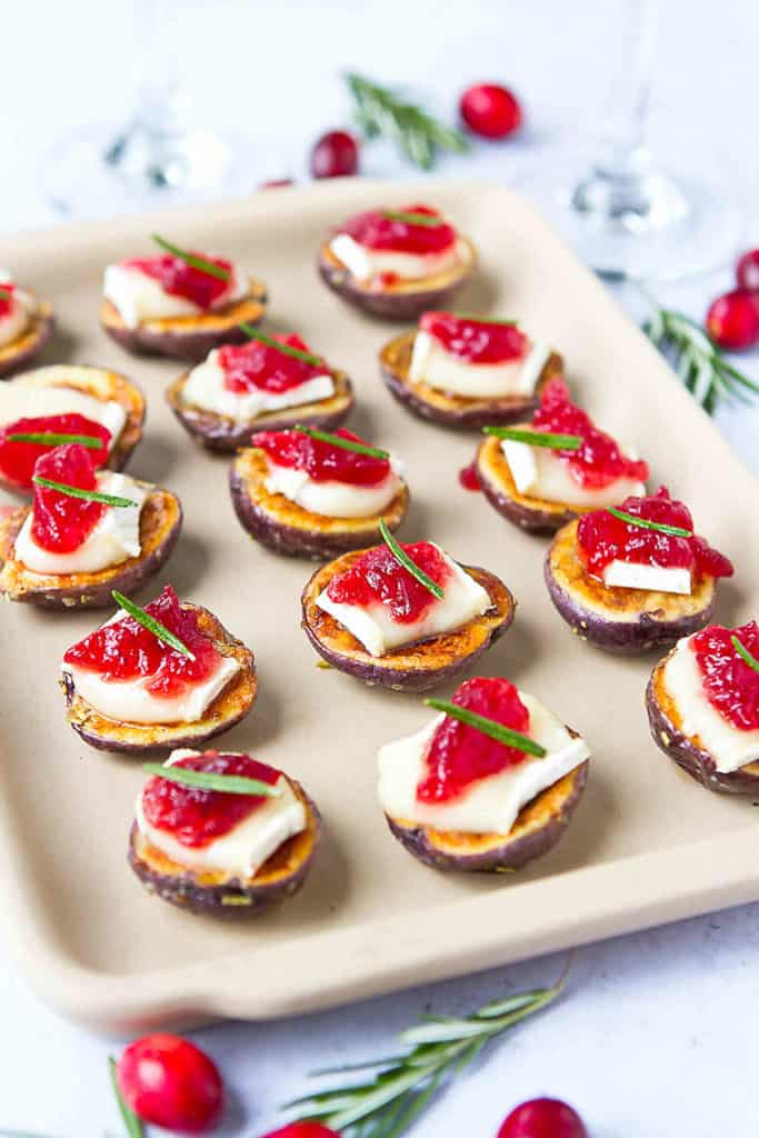 Watch these Brie Cranberry Potato Bites disappear off of your appetizer table in minutes! A little sweet, a little savory and so easy to make. 51 calories and 2 Weight Watchers Freestyle SP #potato #appetizers #Briechese #entertaining