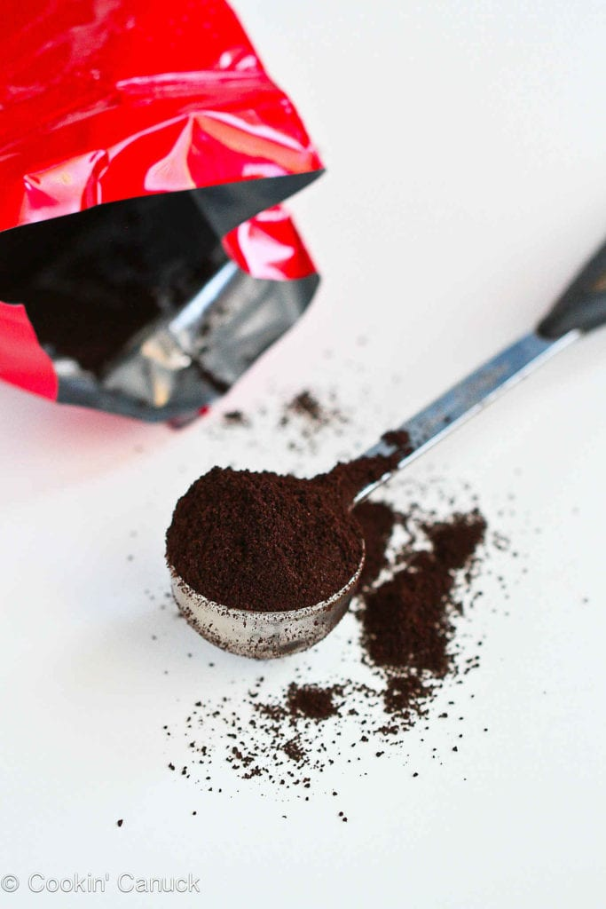 Coffee grounds in a scoop.