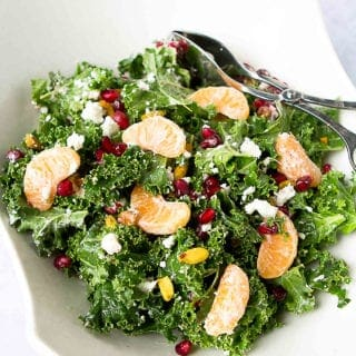 Winter fruit shines in this pretty Kale, Pomegranate and Mandarin Orange Salad. Serve it as a side dish or top it with chicken or shrimp for dinner. 98 calories and 2 Weight Watchers Freestyle SP #kale #cleaneating #weightwatchers