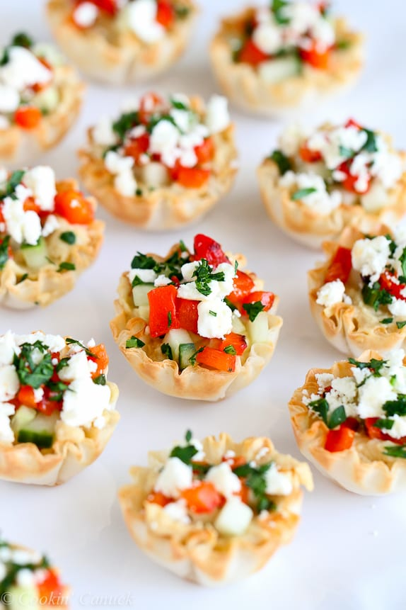 Mini phyllo bites are the ultimate last-minute appetizer. These ones are filled with hummus, roasted peppers and feta cheese. Easy and delicious! 67 calories and 2 Weight Watcher Freestyle SP #healthyappetizer #newyearseverecipes