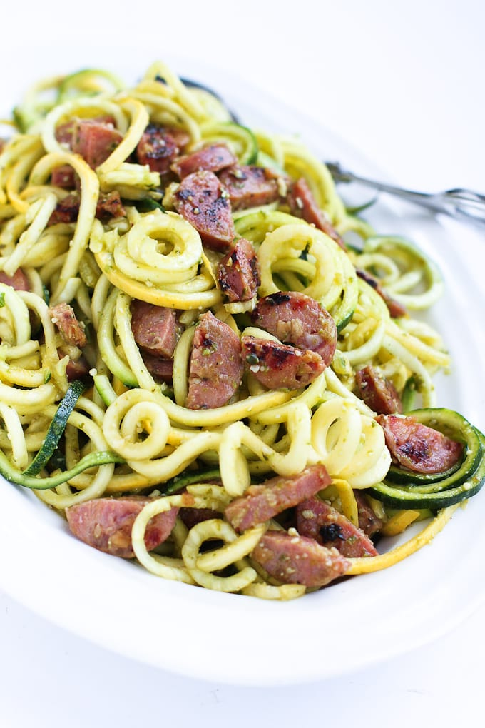 Pesto zucchini noodles, with a dose of chicken sausage, are a fantastic way to enjoy the flavors of your favorite pasta dish without all of the carbs. 205 calories and 4 Weight Watchers Freestyle SP #healthydinner #eatcleaning
