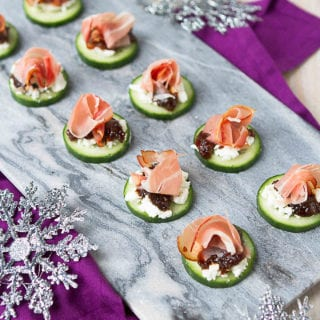 Within 15 minutes, you can have a plateful of savory-sweet prosciutto and goat cheese cucumber appetizers that are guaranteed to disappear in a flash! 24 calories and 1 Weight Watchers Freestyle SP #appetizer #newyearseve