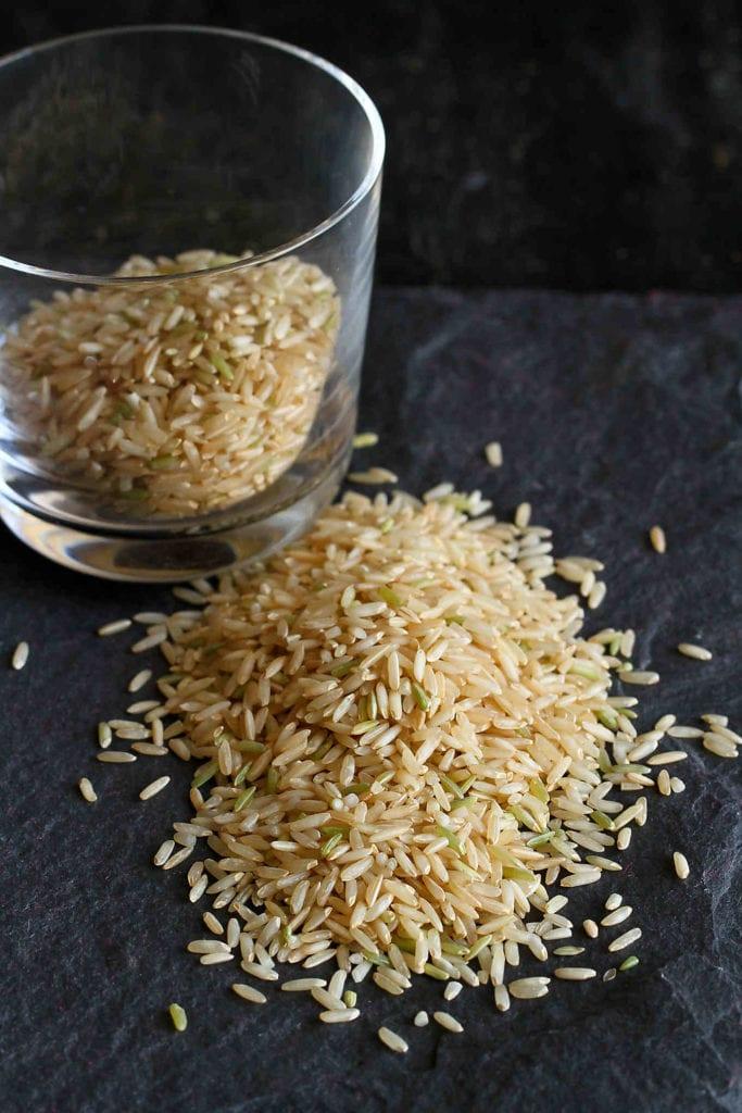 Jasmine rice on a black cutting board.