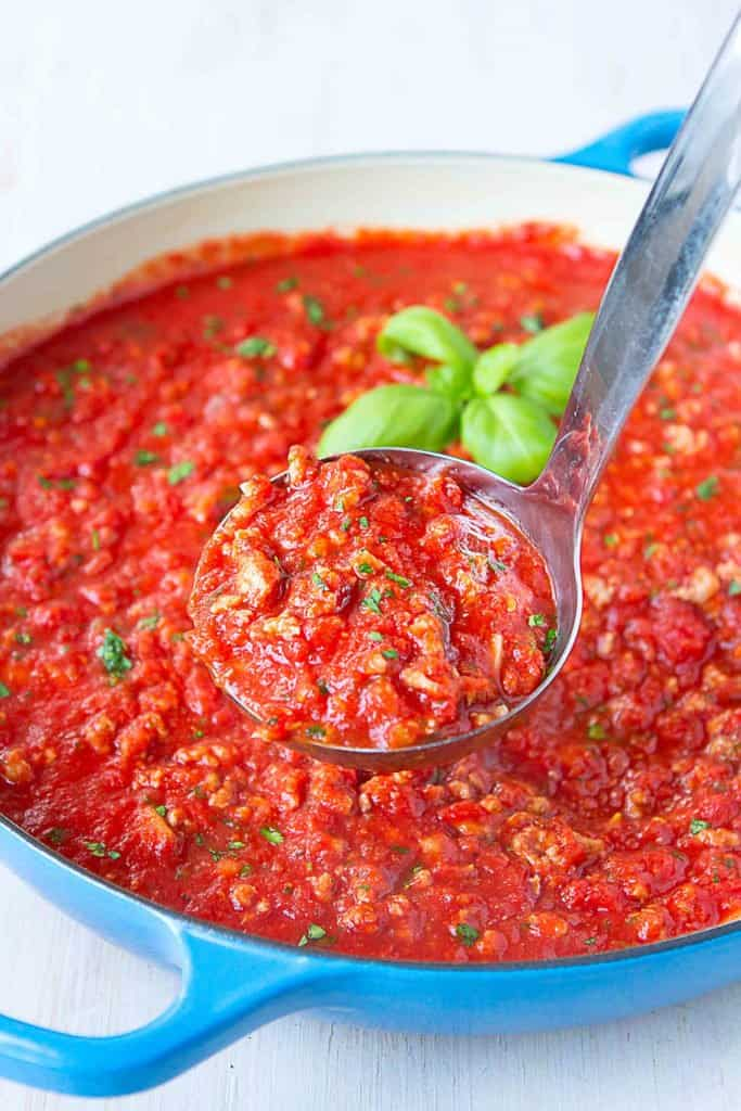 Every home cook needs an easy bolognese sauce recipe on hand for quick weeknight dinners. This healthy version uses ground turkey & chicken sausage, and is packed with flavor! 129 calories and 3 Weight Watchers Freestyle SP #bolognese #cleaneating #weightwatchers