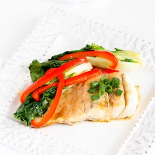 There's no easier way to cook fish than tucked in a foil package, alongside healthy vegetables. Barramundi, a sustainable fish, takes the starring role. 197 calories and 1 Weight Watchers Freestyle SP  #weightwatchers #fish #easydinner
