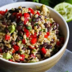 Whip up this easy brown rice and bean salad for your Cinco de Mayo feast, or serve it as a vegetarian entree (vegan and gluten-free, too) any night of the week. 195 calories and 6 Weight Watchers Freestyle SP #rice #beans #salad #vegetarian