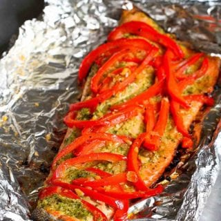 This easy grilled salmon recipe in foil, with basil pesto and sautéed peppers and shallots, requires virtually no clean-up. It's perfect for busy weeknights and entertaining! 254 calories and 1 Weight Watchers SP | BBQ | Baked | Healthy | Keto | Recipes | Packets | With Vegetables | On Grill #salmonrecipes #grilledsalmon #foilpackets #healthygrillingrecipes #ketorecipes #smartpoints