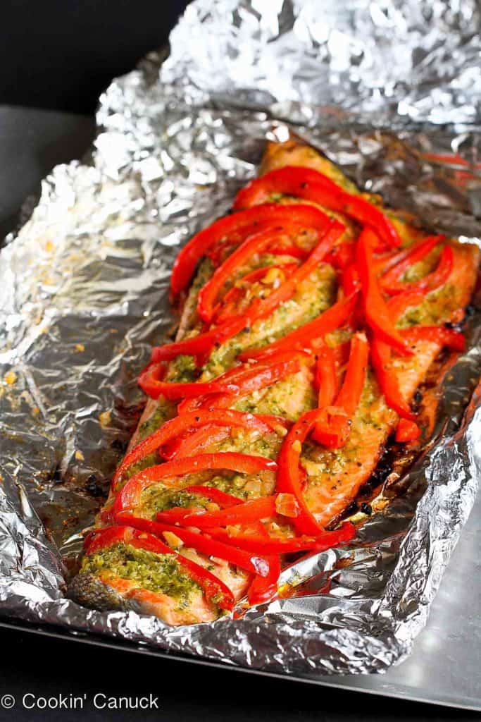 This easy grilled salmon recipe in foil, with basil pesto and sautéed peppers and shallots, requires virtually no clean-up. It's perfect for busy weeknights and entertaining! 254 calories and 1 Weight Watchers SP #salmon #weightwatchers