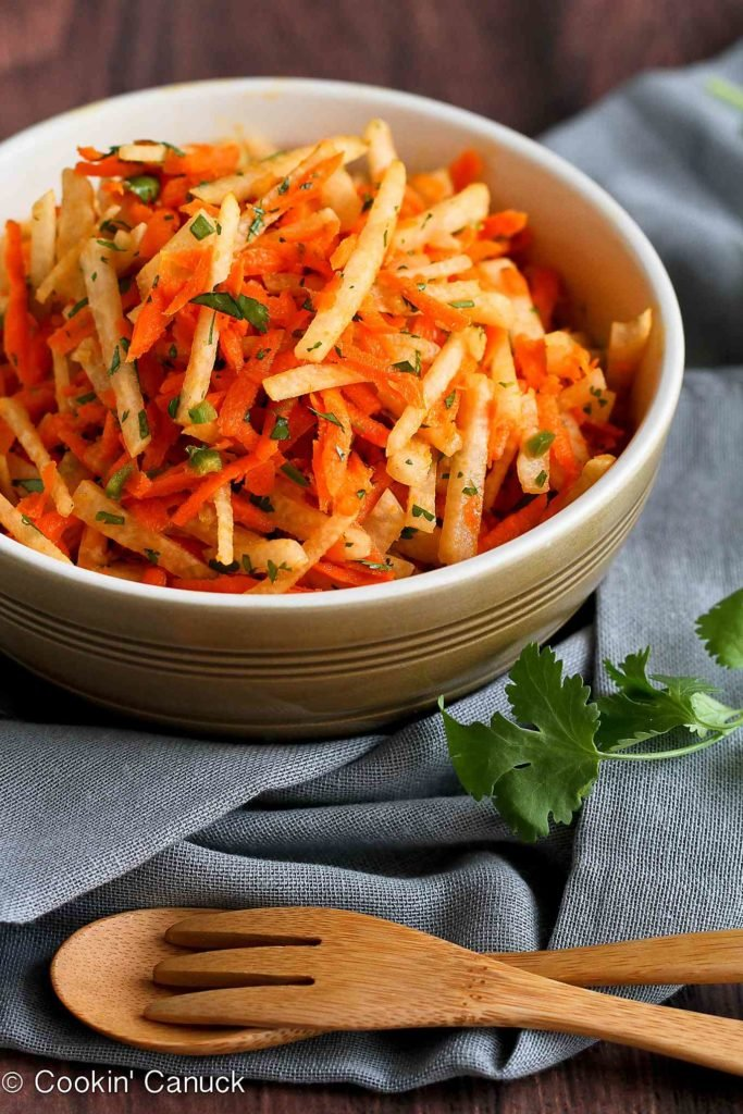 Pile this jicama carrot slaw onto tacos or eat it as a side. Easy to make and delicious! 54 calories and 1 Weight Watchers SP #salad #recipe #slaw