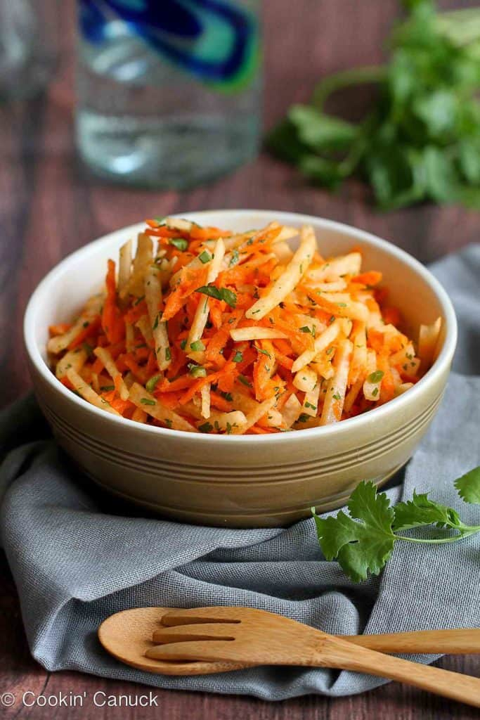 This refreshing jicama and carrot slaw recipe is fantastic served as a side dish or pile high on fish tacos. It's perfect for your Cinco de Mayo party, too! 54 calories and 1 Weight Watchers SP #slaw #jicama #weightwatchers #cleaneating