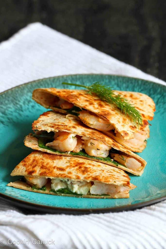 Shrimp seared with garlic and brightened with lemon and dill are tucked into a crispy quesadilla, along with spinach and feta cheese. 257 calories and 5 Weight Watchers Freestyle SP #quesadillas #weightwatchers #shrimp
