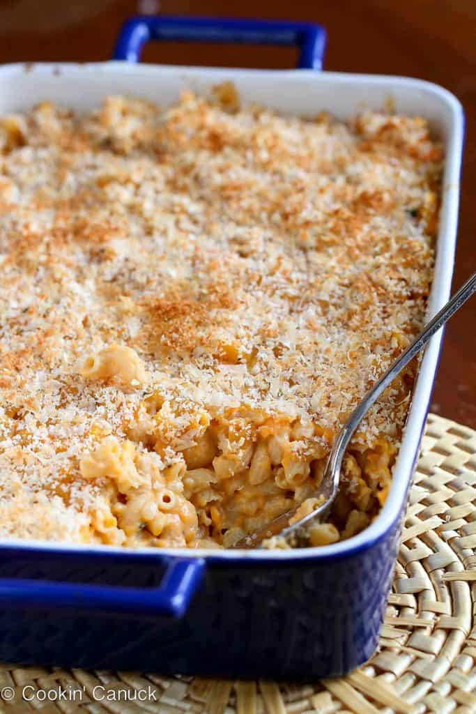 This light(er) macaroni and cheese recipe gets a burst of flavor and texture from mashed sweet potato and a great sharp cheddar cheese. #macncheese #pasta