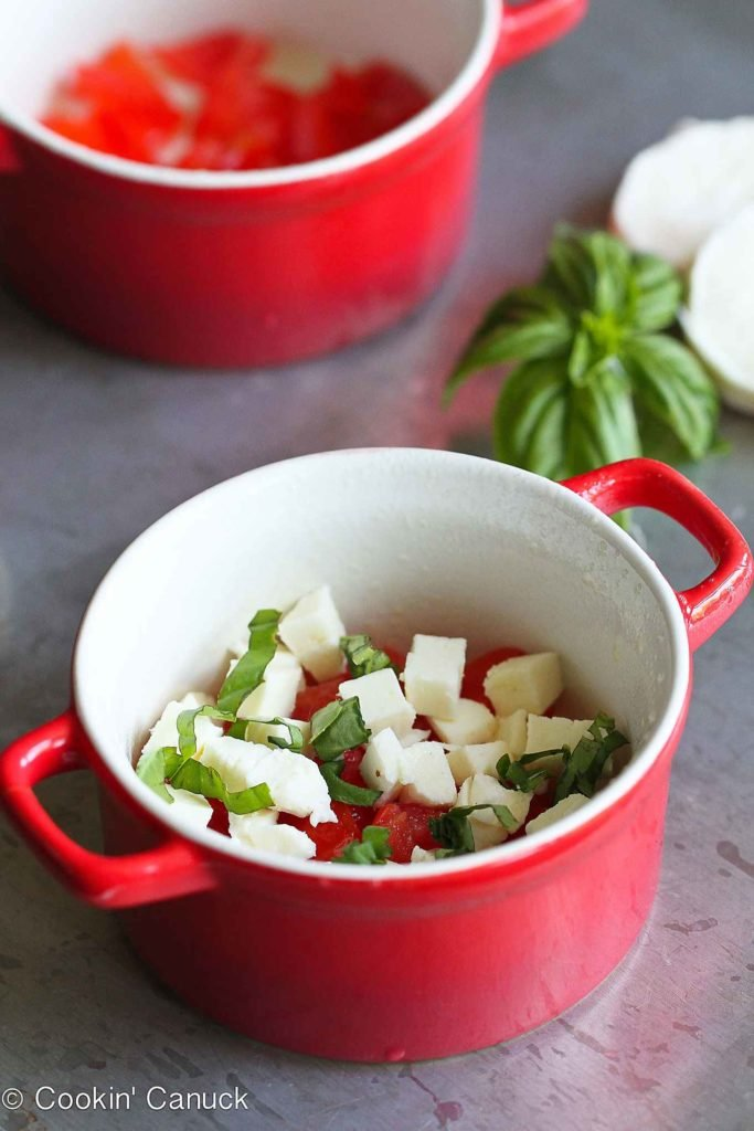 Tomatoes, fresh mozzarella and basil in a ramekin.