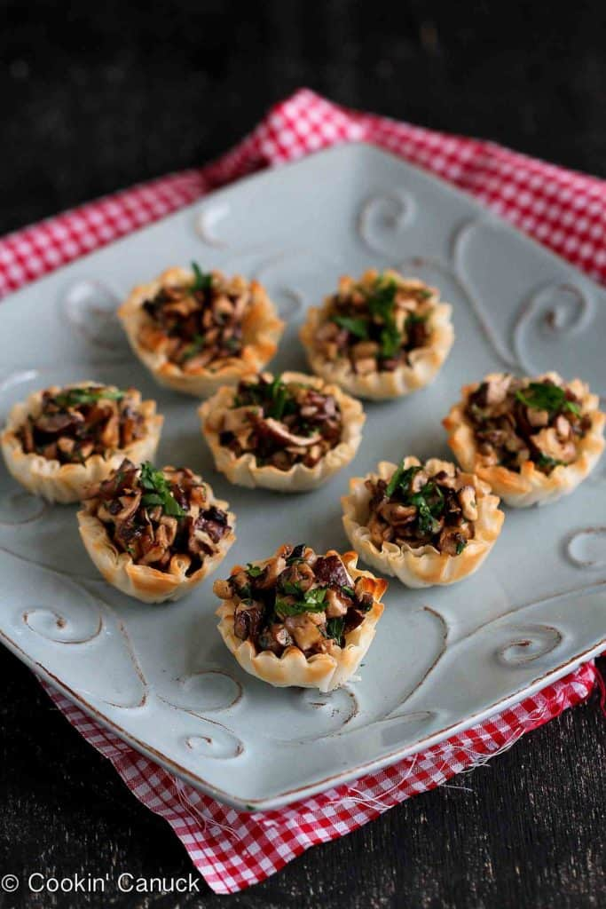 Things are about to get amorous! Pour a glass of red wine and serve up these easy mushroom and Gorgonzola cheese phyllo bite appetizers to kick off the evening. 74 calories and 2 Weight Watchers Freestyle SP #appetizer #phyllo #mushroom