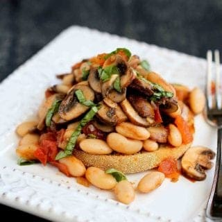 Whip up this flavorful Mushroom, Tomato and Basil Ragout Recipe, and ladle it over a toasted English muffin for a healthy and easy vegan meal. 246 calories and 4 Weight Watchers Freestyle SP #vegan #weightwatchers