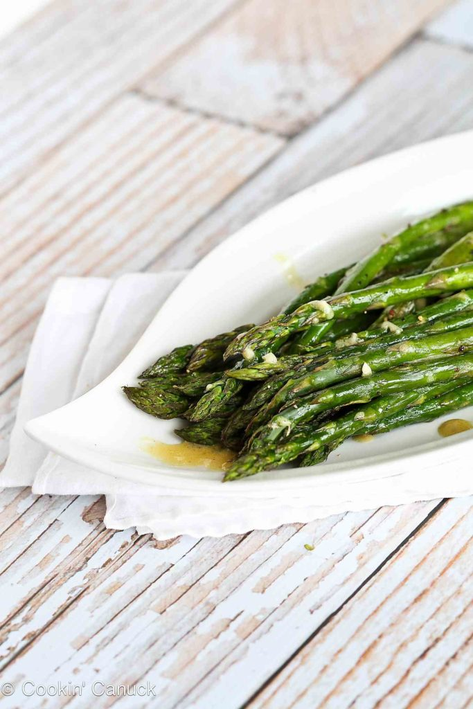 Roasted asparagus is one of the easiest springtime side dishes you can make! This version stars an easy Dijon vinaigrette. 66 calories and 1 Weight Watchers Freestyle SP #sidedish #healthy #recipe