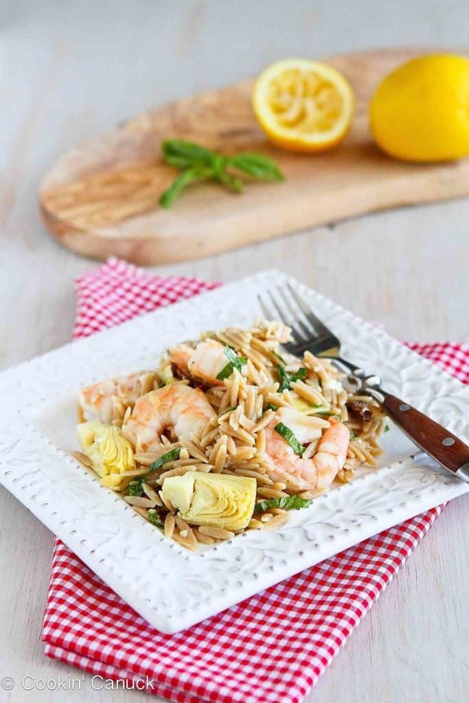 Whip up this pasta salad for a healthy make-ahead meal or to bring to a potluck. Whole wheat pasta, perfectly seared shrimp and artichokes make a fantastic combination! 313 calories and 6 Weight Watchers Freestyle SP #pasta #shrimp #recipe