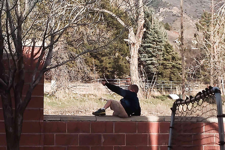 Jumping over brick wall.